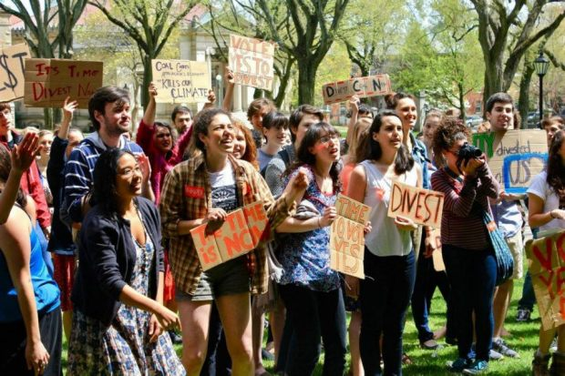 Students from Brown University's Brown Divest Coal Campaign rally on the Main Green.